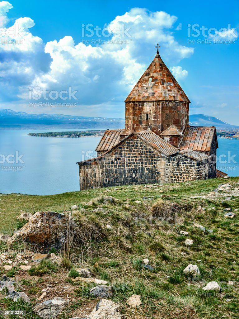 Medieval orthodox monastery and Sevan lake stock photo