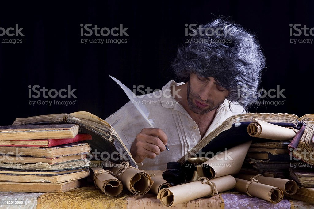 Medieval philosopher writing royalty-free stock photo