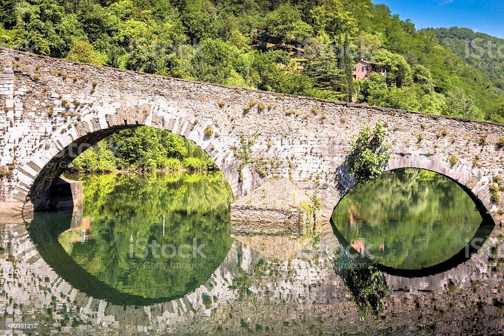Medieval Ponte della Maddalena across the Serchio stock photo
