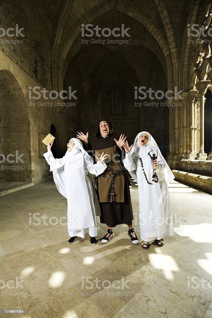 Medieval Priest And Nuns Singing royalty-free stock photo