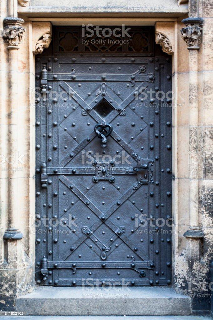 Medieval prison door in old european castle. stock photo