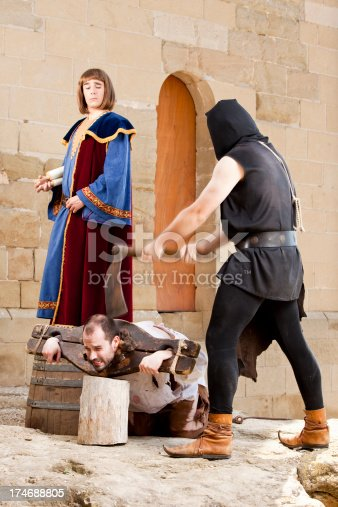 Medieval public beheading with guillotine.