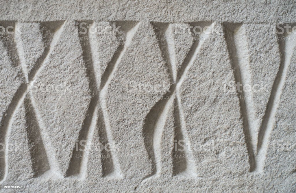 Medieval Roman Numerals Carved in Stone royalty-free stock photo