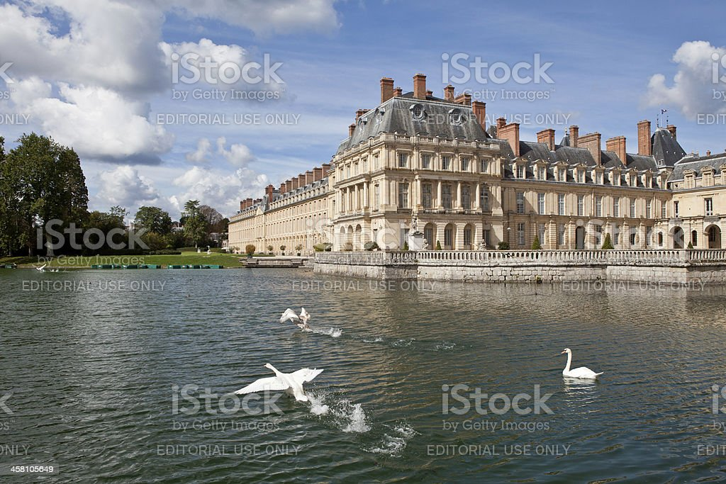 Medieval royal castle Fontainbleau and lake near Paris in France stock photo