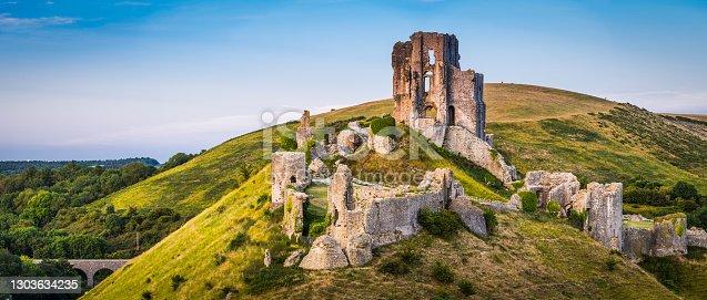 istock Medieval ruins Corfe Castle sunset panorama Isle Purbeck Dorset UK 1303634235
