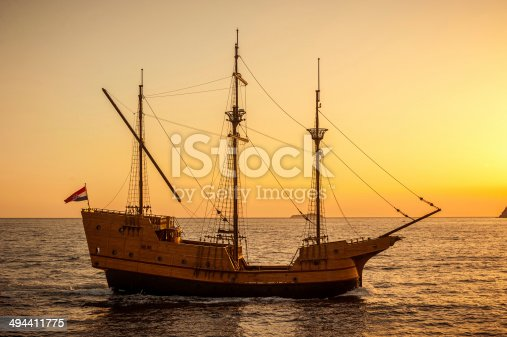 istock Medieval sailing ship in sunset 494411775