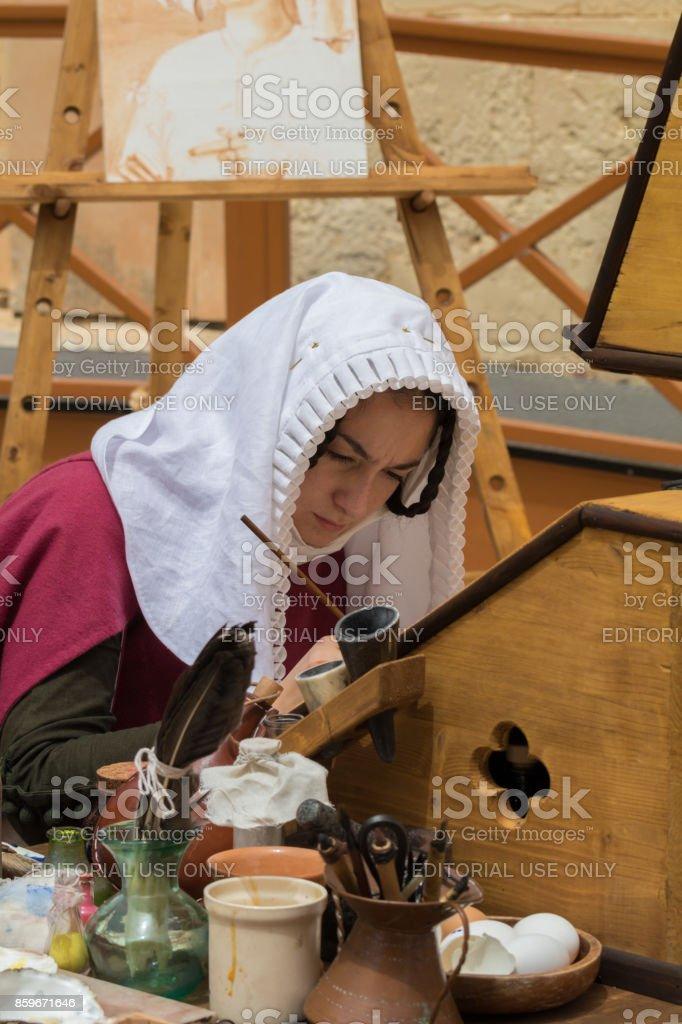 Medieval scribe stock photo