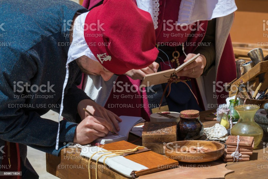 Medieval scribes  writing calligraph stock photo