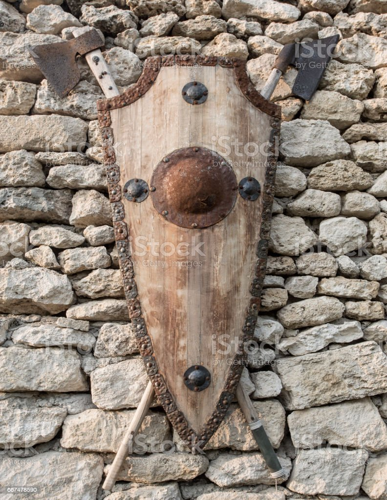 Medieval shield and axes. stock photo