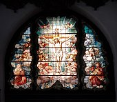 Havana, Cuba - December 13, 2014: Stained glass window depicting the Madonna and child inside the Iglesia Del Sagrado Corazon de Jesus in Havana, Cuba. The 77-meter tall church is the tallest in Havana and contains 69 stained glass windows. The church was inaugurated in 1923.