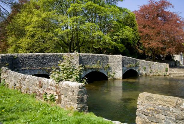 medieval stone packhorse bridge ashford in the water peak district national park derbyshire england uk stock photo