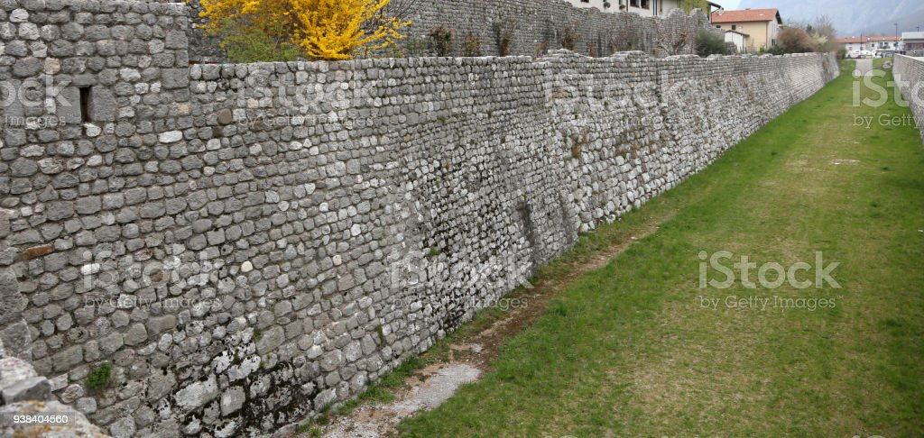 medieval stone wall in Venzone town in Northen Italy stock photo