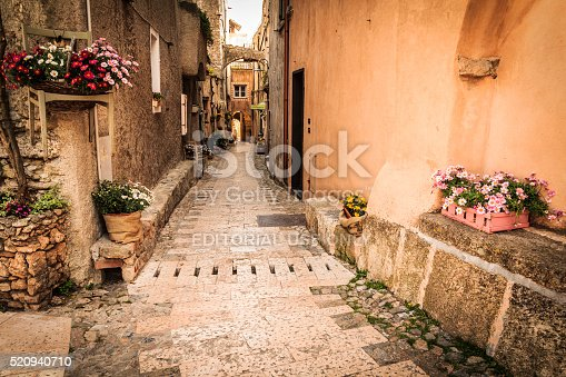 Verezzi, Italy-07 April, 2016: medieval street alley with flowers and plants.