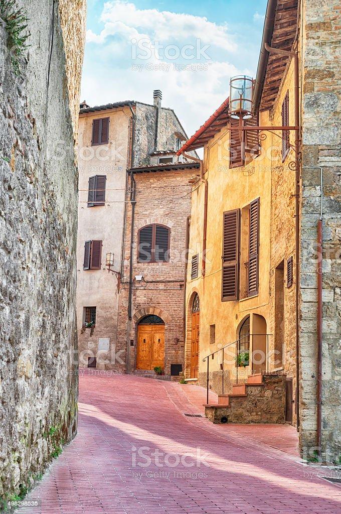 Medieval street in San Gimignano, Italy. stock photo