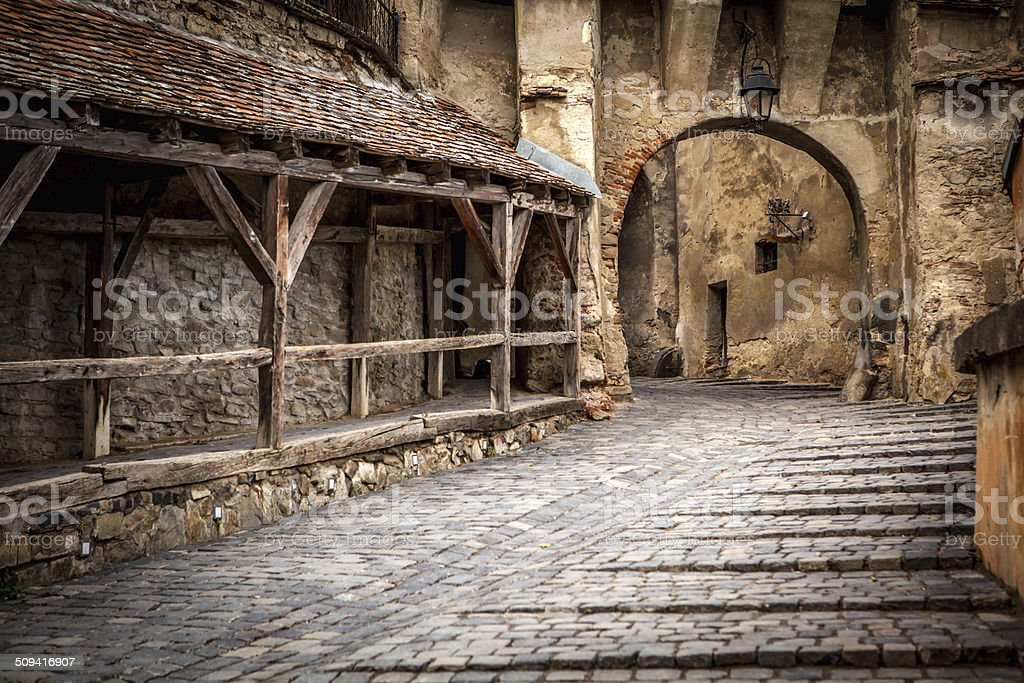 Medieval street view in Sighisoara, Transylvania stock photo