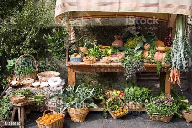 Medieval Style Market Stalk Selling All Fresh Produce Stock Photo - Download Image Now