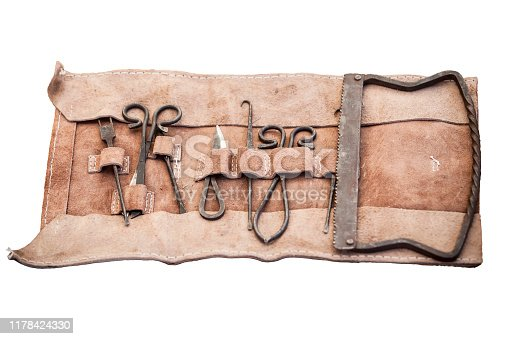 Medieval surgery doctors tools in leather wrap. Isolated