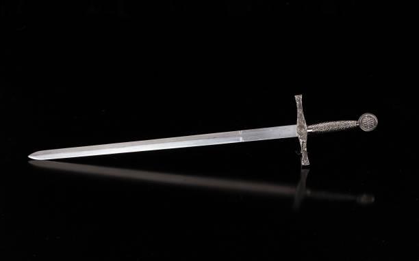 medieval sword on a black isolated background - sword zdjęcia i obrazy z banku zdjęć