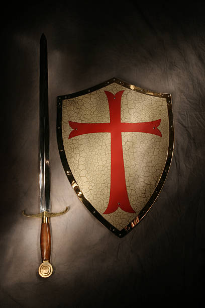 medieval sword & shield with dramatic lighting - the crusades stock photos and pictures