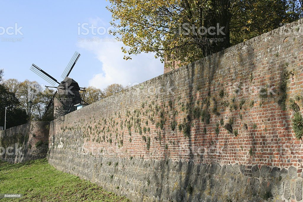 medieval town wall and windmill royalty-free stock photo