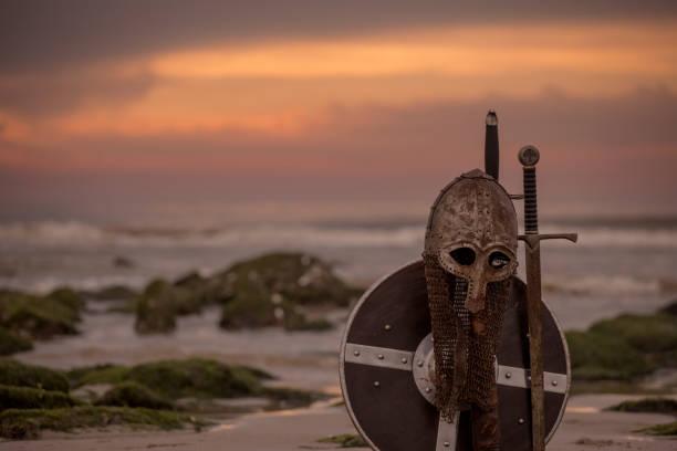 medieval warrior equipment on a cold seashore at dusk - tarcza broń zdjęcia i obrazy z banku zdjęć