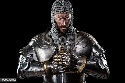 istock Medieval Warrior with Chain Mail Armour and Sword 525035812