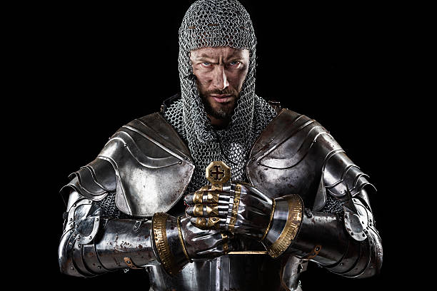 medieval warrior with chain mail armour and sword - warrior person stock pictures, royalty-free photos & images