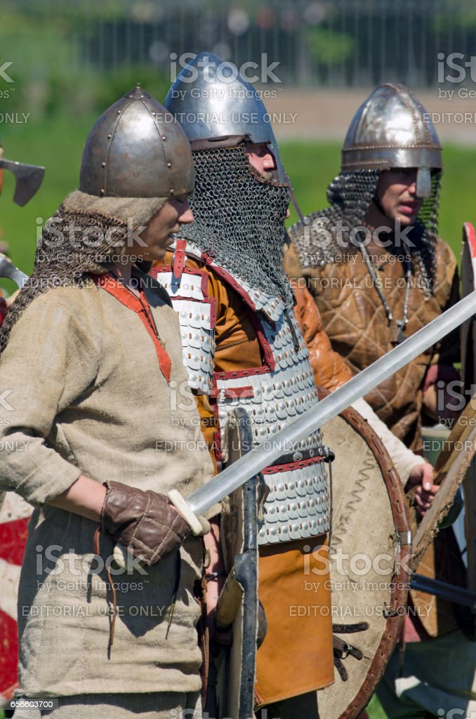 Medieval Warriors Clad In Armor And Helmets Standing In A Row Stock Photo -  Download Image Now