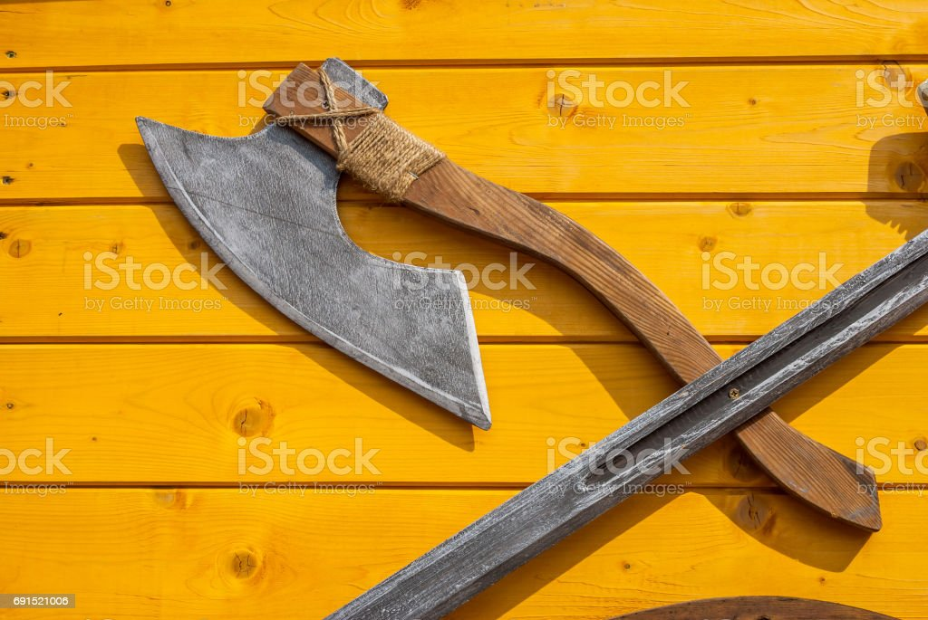 medieval weapons on wooden desk. close up stock photo