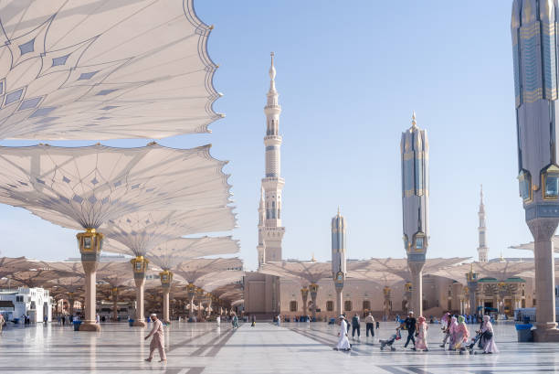 Medinah Masjid Decorations These Umbrella construction on the square of Al-Masjid An-Nabawi or Prophet Muhammed Mosque are protecting people from sun at daytime and work as lights at night umrah stock pictures, royalty-free photos & images