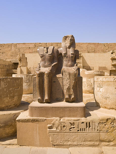 Medinet Habu temple Granite statues at the hypostile hall of Medinet Habu temple. Thebes.  Tomb Of Ramses III stock pictures, royalty-free photos & images