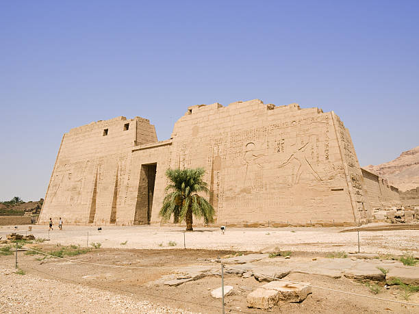 Medinet Habu Temple First pylon panoramic.  Tomb Of Ramses III stock pictures, royalty-free photos & images