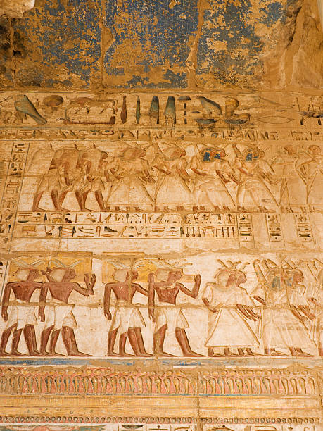 Medinet Habu Temple Ancient Egyptian relieves. Tomb Of Ramses III stock pictures, royalty-free photos & images