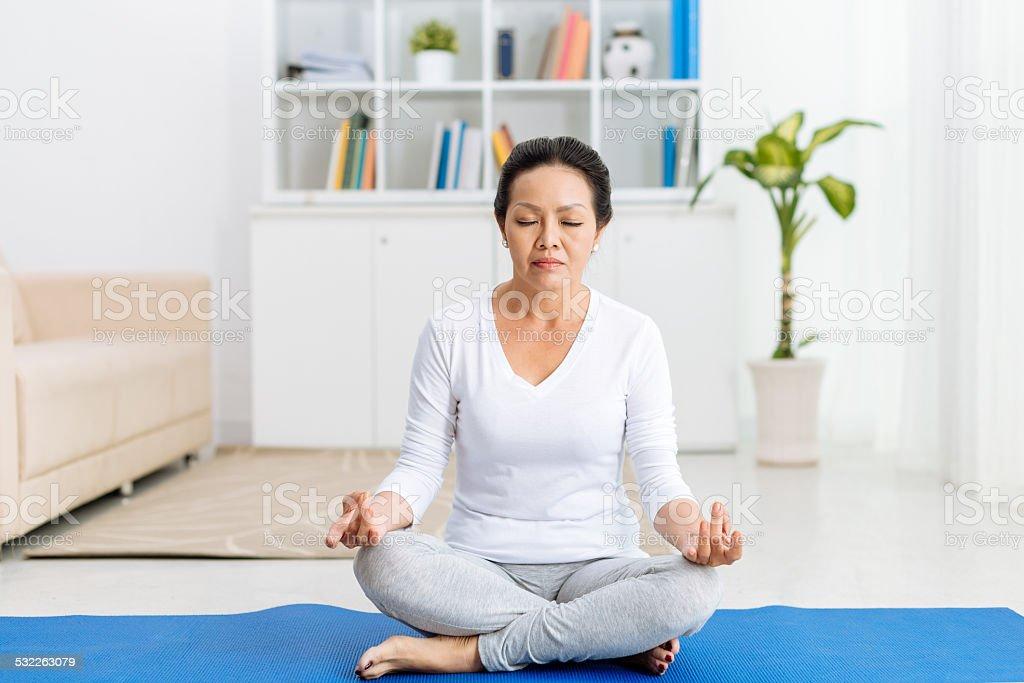 Meditating at home stock photo
