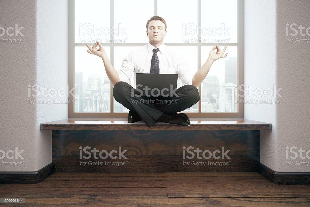 Meditating businessman in interior foto royalty-free