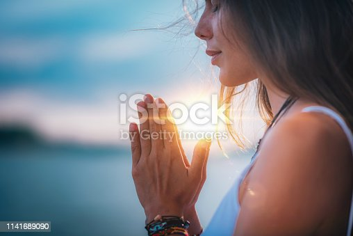 istock Meditating. Close Up Female Hands Prayer 1141689090