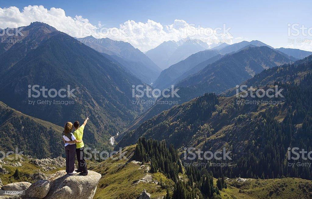 Meditating couple at summit royalty-free stock photo