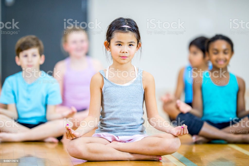 Meditating Crosslegged stock photo