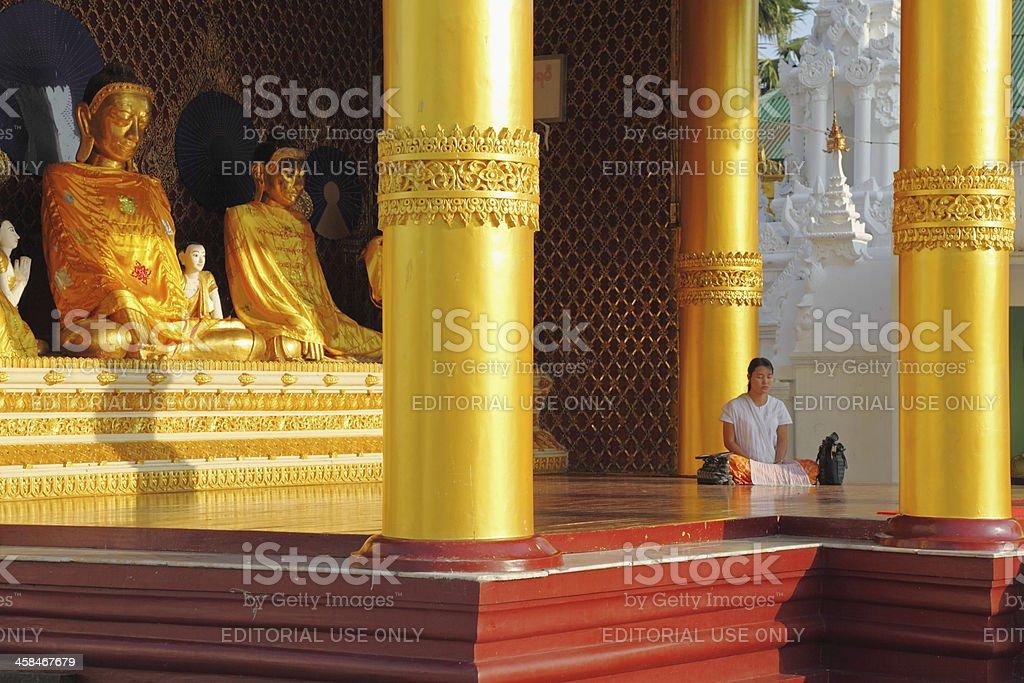 meditating female pilgrim at the buddhist Shwedagon pagoda royalty-free stock photo