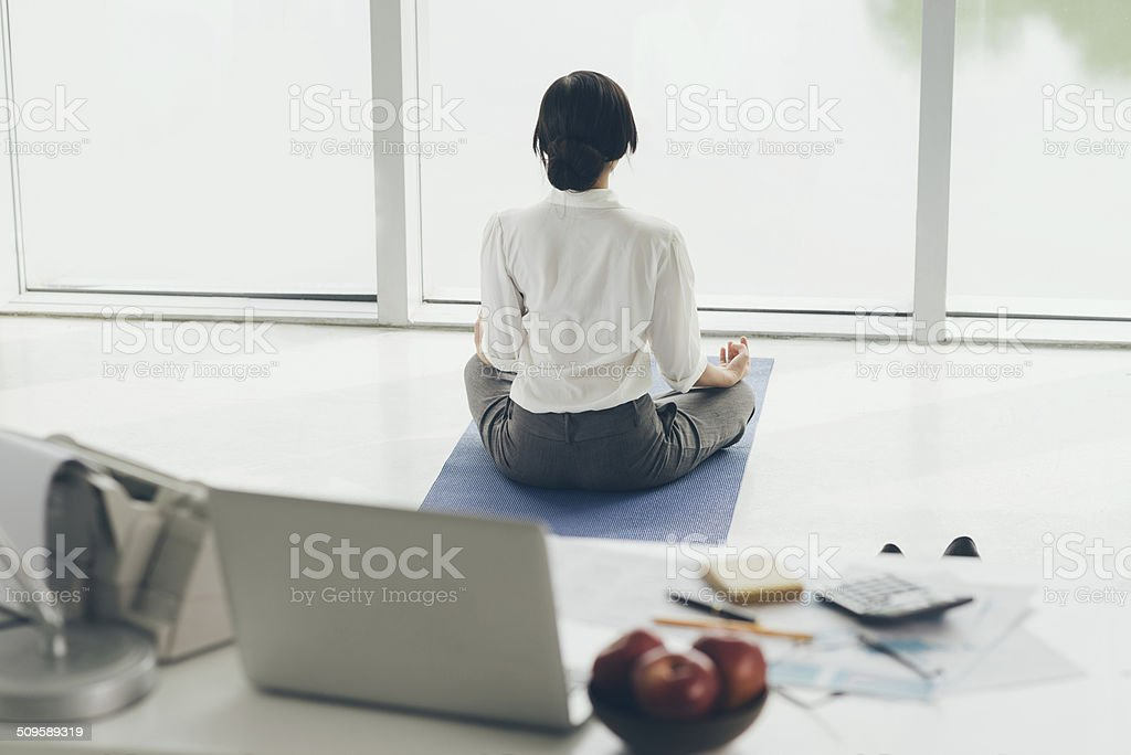 Meditating in the morning stock photo
