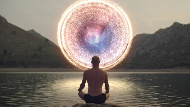 meditating man opening portal to cosmic energy. - spirituality stock pictures, royalty-free photos & images