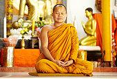 istock Meditating monk in a sacred shrine 154282280
