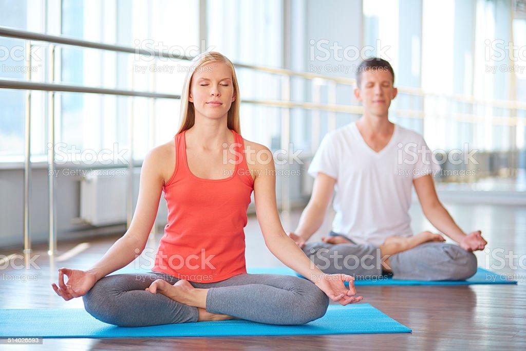 Meditating together stock photo
