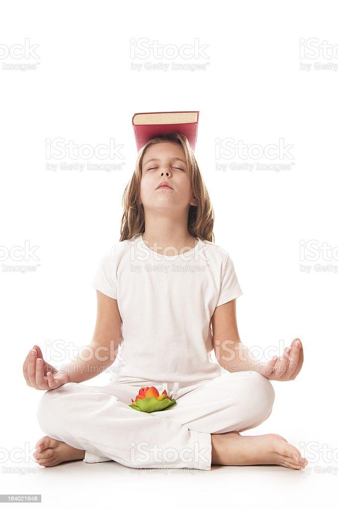 meditating witk  book royalty-free stock photo
