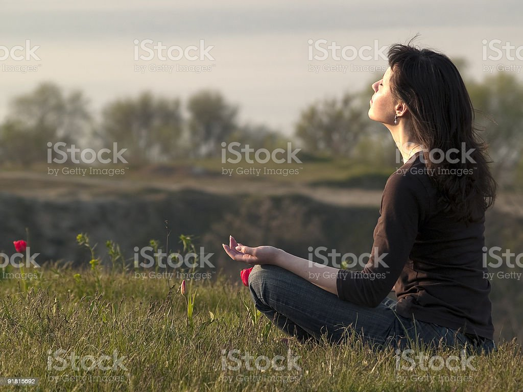 Meditating woman royalty-free stock photo