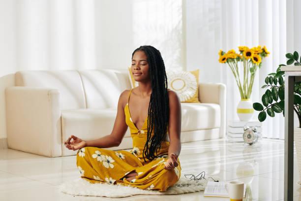 Meditating youn woman stock photo