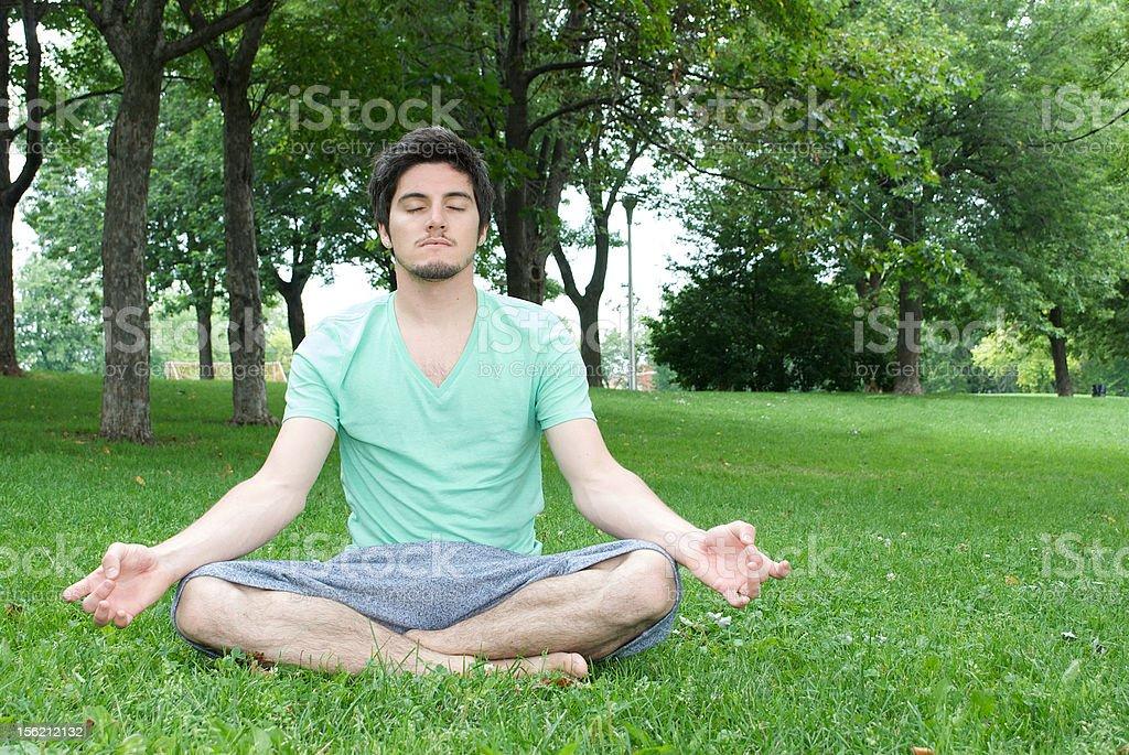 Meditating young man royalty-free stock photo