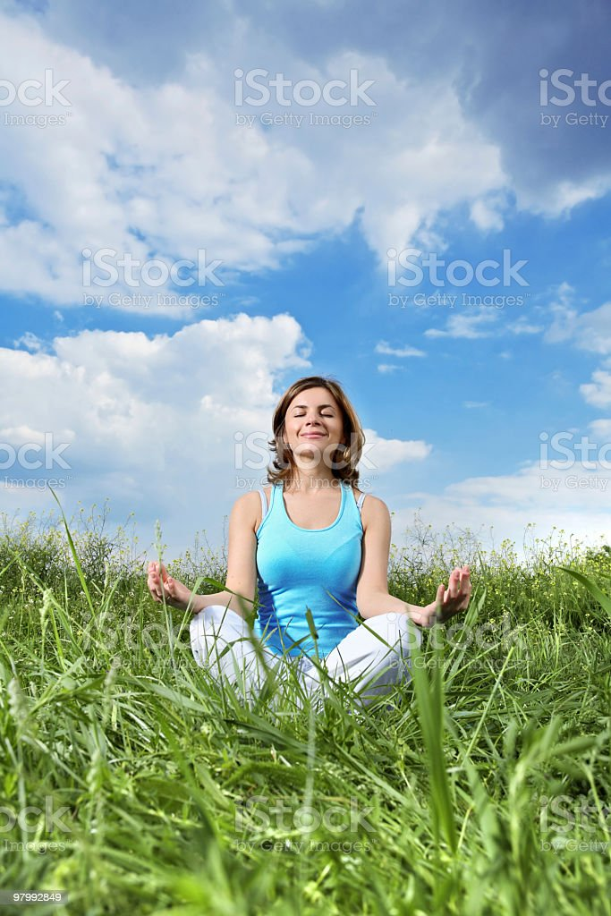 Meditation against the sky. royalty-free stock photo