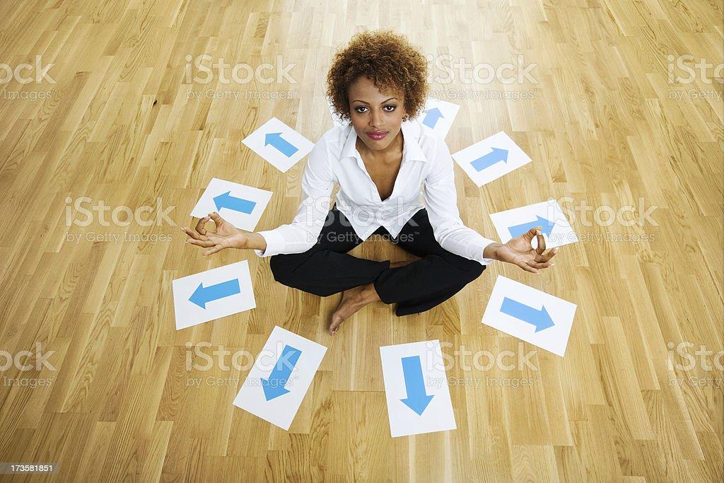 Meditation among arrow signs stock photo