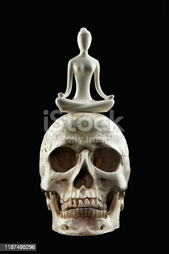 istock meditation and yoga on skull isolated on black background with clipping path 1187495296